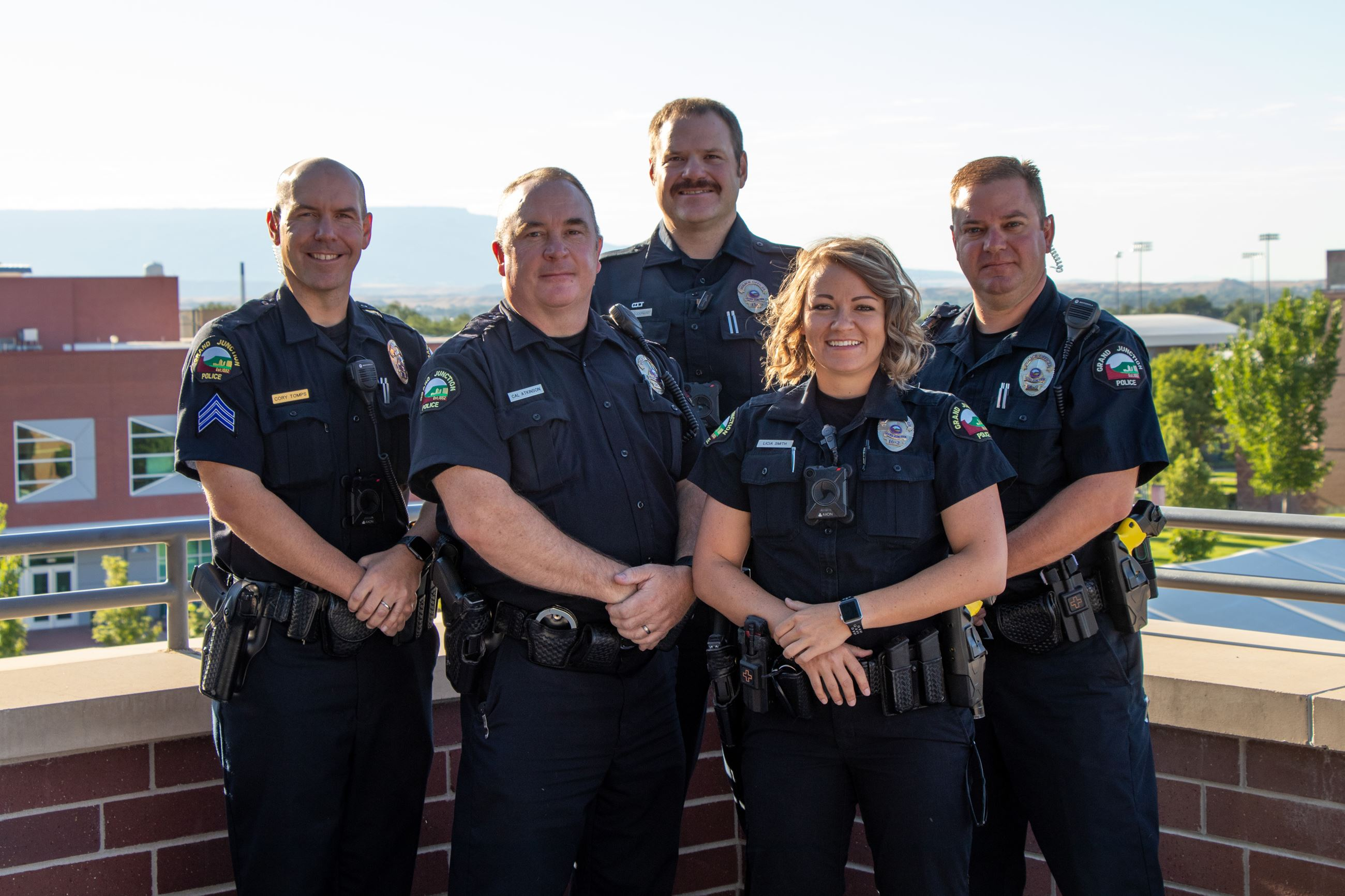 5 Grand Junction Police Department Officers  smiling